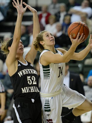 UWGB guard Megan Lukan (14) lays up a shot past Western Michigan's Jessica Jessing (52) in the first half at the Kress Center in Green Bay.