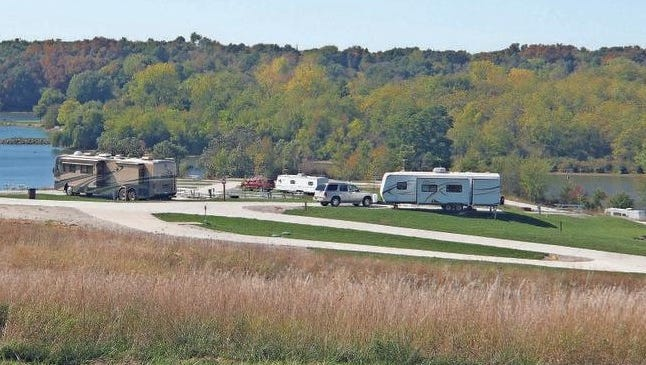 Shown here is a late season camper enjoying the beginning of fall colors at Diamond Lake. Last year, the Conservation Board changed its policy to allow the Diamond Lake campgrounds to remain open year-a-round giving campers additional time to enjoy the park.
