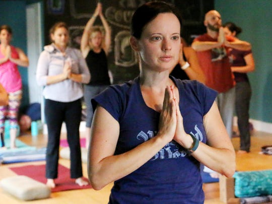 A yoga class at Greenville Yoga on Stone Avenue in Greenville helps parents de-stress.