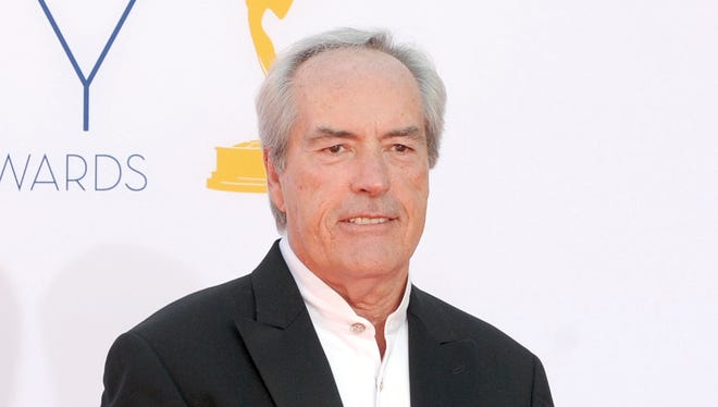 In this Sept. 23, 2012 file photo, Powers Boothe arrives at the 64th Primetime Emmy Awards in Los Angeles. Boothe died Sunday, May 14, 2017. He was 68.