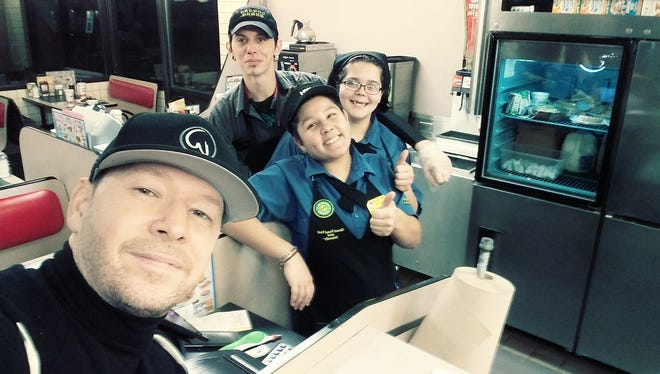 Donnie Wahlberg takes a selfie with employees at an Indianapolis Waffle House on Nov. 25, 2017.