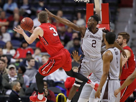 Davidson guard Jon Axel Gudmundsson (3) jumps to shoot past St. Bonaventure guard Matt Mobley (2) during the second half of an NCAA college basketball game in the semifinals of the Atlantic 10 Conference tournament, Saturday, March 10, 2018, in Washington.  Davidson won 82-70. (AP Photo/Alex Brandon)