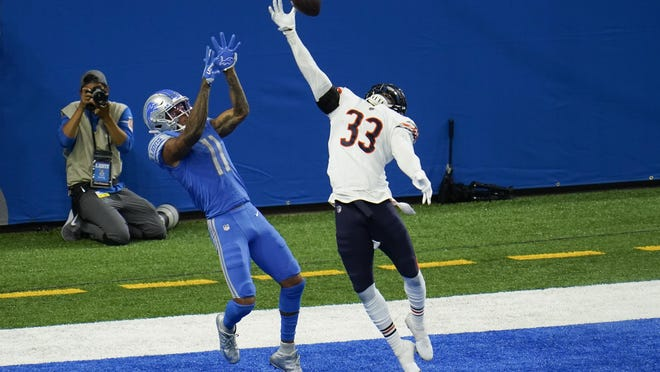 Chicago Bears cornerback Jaylon Johnson (33) breaks up a pass intended for Detroit Lions wide receiver Marvin Jones (11) in the end zone in the fourth quarter of an NFL football game in Detroit, Sunday, Sept. 13, 2020. Chicago won 27-23.