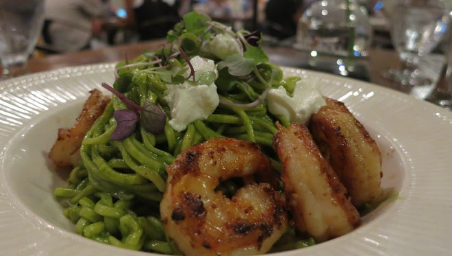 Grilled Okemos-grown shrimp are served with hand-rolled spaghetti in spinach-and-nettle sauce and local goat cheese at the Mulefoot Gastropub in Imlay City.