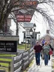 Tourists walk past restaurants and shops in the Amana