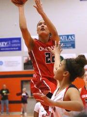 Oakland's Maddie Cook (22) goes up for a shot as Blackman's