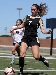 Rider's Marissa Lifland passes in the Region I-5A area playoff against Arlington Heights Friday, March 31, 2017, at the Birdville ISD Fine Arts and Athletics Complex in North Richland Hills. The Lady Raiders defeated Arlington Heights 2-0.