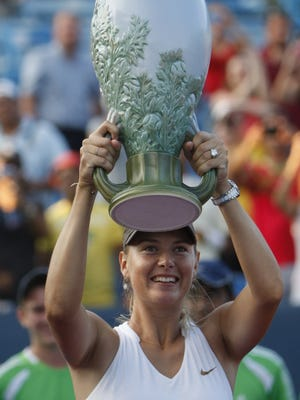 2011 Western & Southern winner Maria Sharapova hoists the Rookwood trophy. Make sure the tennis fan on your list gets to see Maria Sharapova try to hoist another Rookwood trophy. The Enquirer/Gary Landers TENNIS.  SPORTS.  AUGUST 21, 2011. Maria Sharapova of Russia, holds the Rookwood throphy over her head after defeating Jelena Jankovic of Serbia in the championship match of the ATP World Tour Masters 100 Western & Southern Open held in Mason, Ohio Sunday August 21, 2011. The Enquirer/ Gary Landers