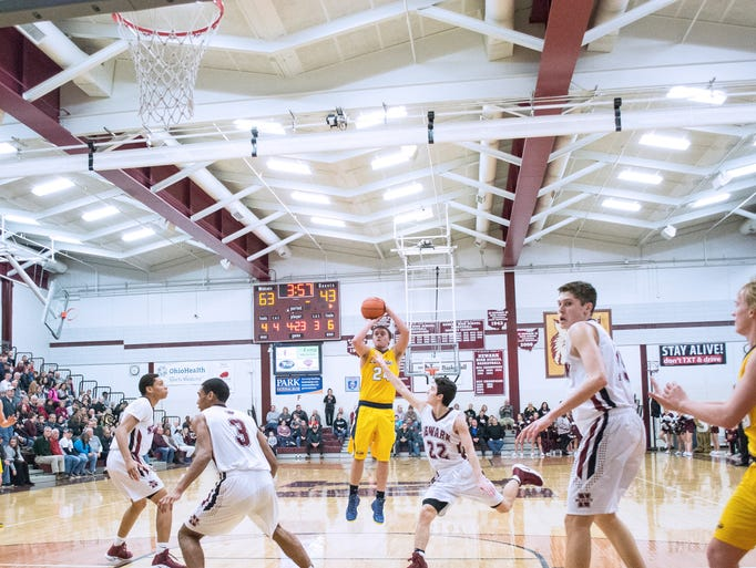 Lancaster's Austin Gootee connects for two points during