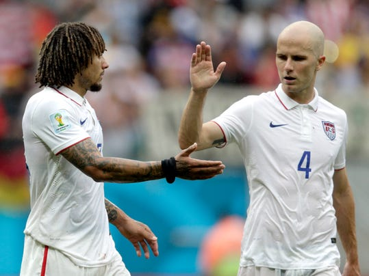 United States' Michael Bradley, right, congratulates his teammate Jermaine Jones after qualifying for the next World Cup round following their 1-0 loss to Germany during the group G World Cup soccer match between the USA and Germany at the Arena Pernambuco in Recife, Brazil, Thursday, June 26, 2014. (AP Photo/Julio Cortez)