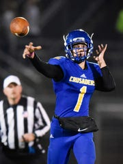 St. Cloud Cathedral quarterback Isaiah Anderson throws