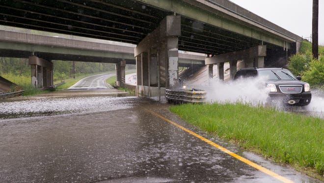 Standing water forces the closing of the southbound lanes of S. Indianapolis Road, Indianapolis, Thursday, May 4, 2017. Today's rainy day adds to the approximately two-and-a-half inches of rain that's expected in central Indianapolis through Friday.