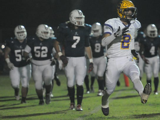 Smyrna's Percy Whittaker celebrates a touchdown at