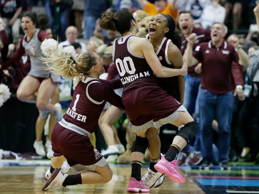 Mississippi State guard Morgan William, right, celebrates with teammates after she hit the winning shot against Connecticut in an NCAA college basketball game in the semifinals of the women's Final Four, Saturday, April 1, 2017, in Dallas. Mississippi State won 66-64. (AP Photo/LM Otero)