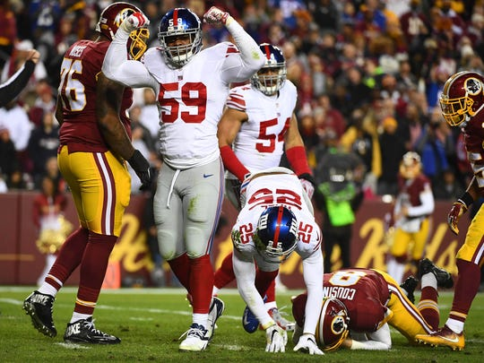 Giants linebacker Devon Kennard (59) celebrates after