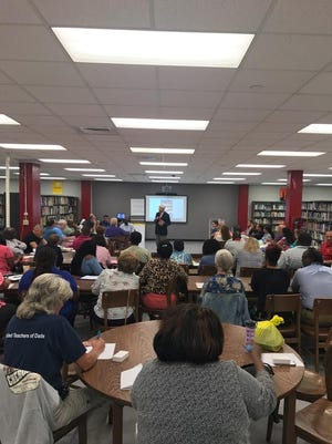 """Sen. Bob Graham speaks to a group of teachers learning about """"effective citizenship"""" based on his book """"America: The Owner's Manual."""""""