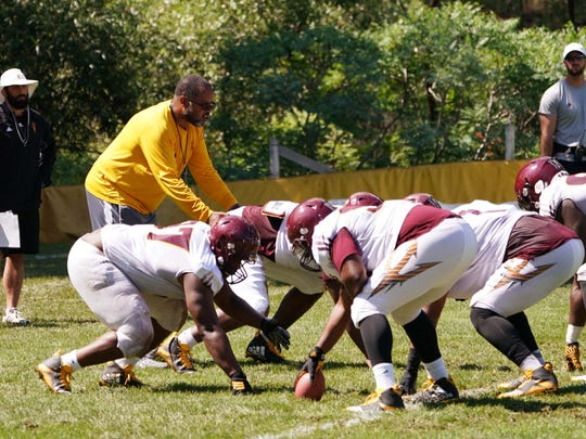 Arizona State assistant coach Michael Slater works with the defensive linemen at Camp Tontozona on Wednesday, Aug. 2 , 2017 in Kohls Ranch, Ariz.