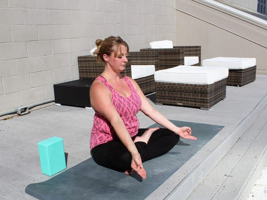 Cristal Willcox teaches a yoga class on the rooftop at Remington Suite Hotel and Spa 5:45 p.m Mondays.
