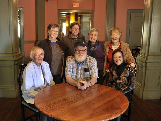 Former Stone Soup workers-owners gathered for a reunion in 2012 at the Manor Inn, a site of one of the restaurant's original locations. Pictured (L to R): Mary Gilbert, Dick Gilbert, Deborah Miles. Standing: Penny White, Zoe Rhine, Carolyn Wallace, Jo Bell.