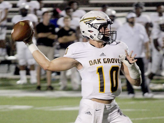 Oak Grove quarterback John Rhys Plumlee throws a pass Friday during the Warriors' game against Meridian.