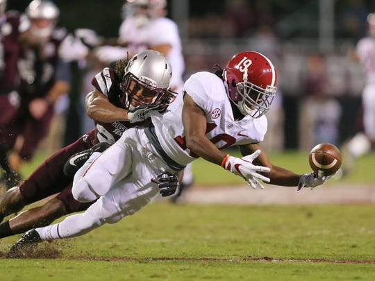 Alabama's Xavian Marks (19) recovers a loose ball after