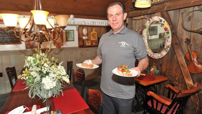 Strawberry Fair owner Marko Fani prepares to serve breakfast in his Norwell restaurant.