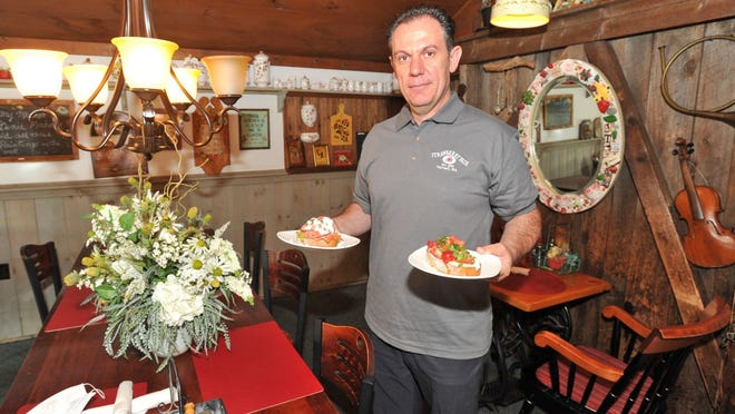 Strawberry Fair owner Marko Fani prepares to serve breakfast in his Norwell restaurant.