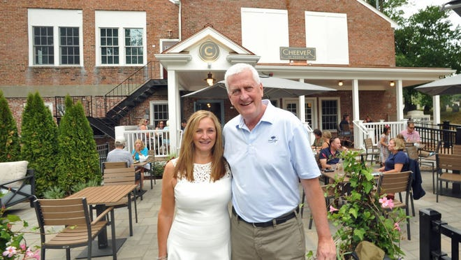 Cheever Tavern general manager Stefanie Healy and owner Mike Sheehan pose in front of their Norwell restaurant,Thursday, Aug. 13, 2020. Tom Gorman/For The Patriot Ledger