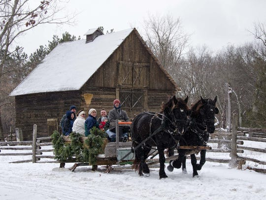 Old World Wisconsin hosts an annual Christmas celebration. A volunteer was killed earlier when a tree he wa cutting here fell on him.