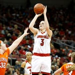 Louisville's Sam Fuehring pulls up for the jumper over Clemson's Morgan Ross (#32) and Victoria Cardaci. Jan. 28, 2016