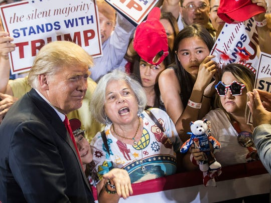 Donald Trump takes a picture with Diana Brest of Phoenix,