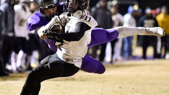 Whitehaven's Cameron Sneed (11) is tackled by Cane Ridge's Jahsun Bryant (11) during the first half of the Class 6A semifinal at Cane Ridge High School in Antioch, Tenn., Friday, Nov. 24, 2017.
