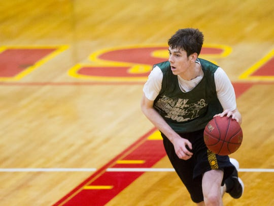 Iowa City West forward Patrick McCaffery takes the ball up court during a basketball game in the Justin Sharp Memorial Shootout at Rock Island High School on Friday, June 22, 2018 in Rock Island, Illinois.