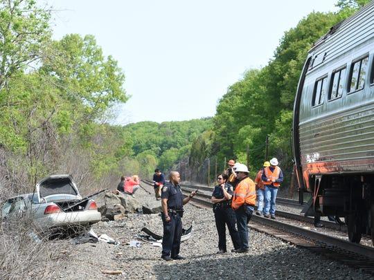An Amtrak train struck a car in Hyde Park this morning.