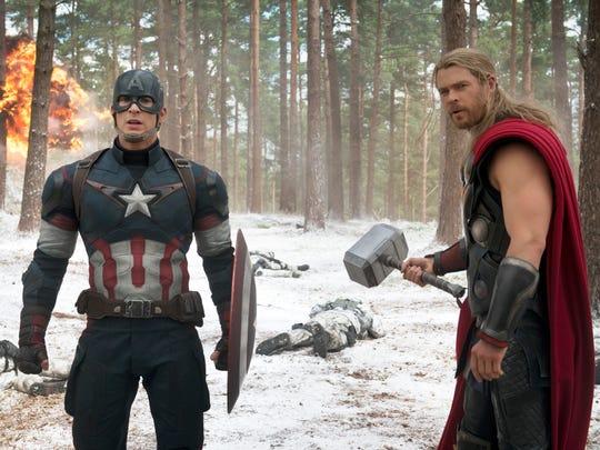 Chris Evans (lef,) and Chris Hemsworth don superhero