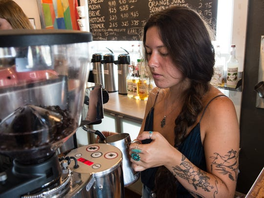 Barista Alejandra Vansant makes a coffee drink for a customer at Main Street Shop and Coffeehouse in Chincoteague on Friday, July 7, 2017.