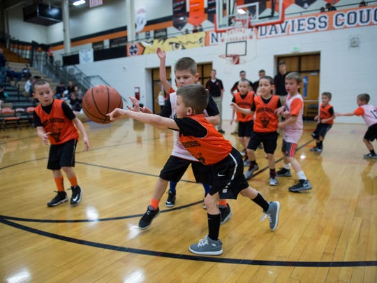 Kindergartens and first-graders of the Future Cougars basketball team play during halftime of the junior varsity game at North Daviess High School on Thursday, Feb. 16, 2018.