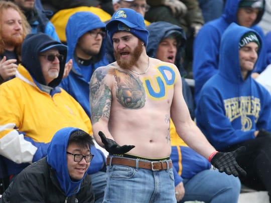 A Delaware fan reflects his team's frustrations on the field in the second quarter at Villanova Stadium Saturday.