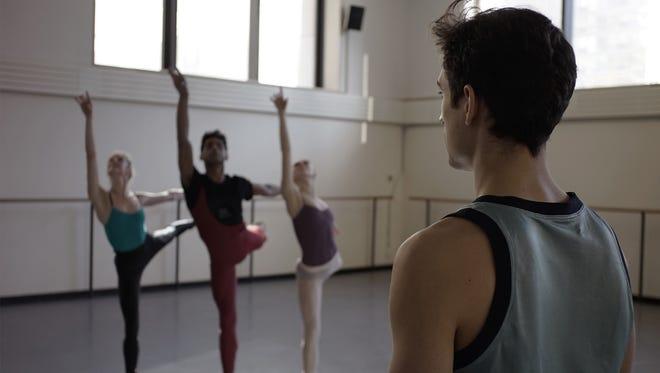 "Justin Peck (right)  watches   dancers rehearse his ballet ""Paz de la Jolla."""
