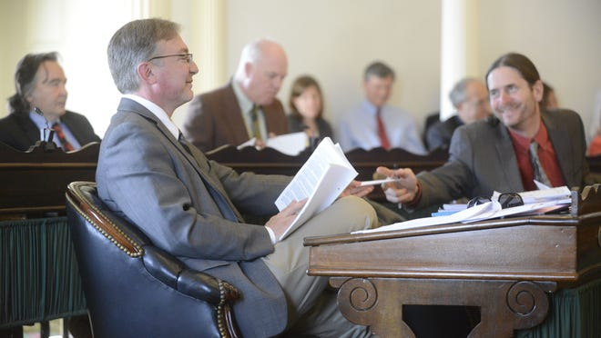 Sen. David Zuckerman, P/D-Chittenden, right, passes a paper to Sen. Philip Baruth, D-Chittenden, during a lengthy discussion of Vermont school district structure and tax rates Thursday. Zuckerman and Baruth each supported the Senate version of an education governance overhaul.