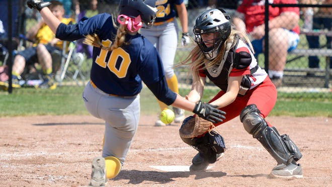 Westfall's Regan Stonerock attempts to catch the softball and tag out South Point during the Division III district final game at Unioto High School on Saturday. The final score was Westfall 10, South Point 14.