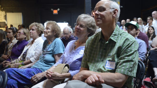 Residents of Burlington's South End pack Arts Riot on Tuesday evening to hear city officials present a draft development plan for the neighborhood.
