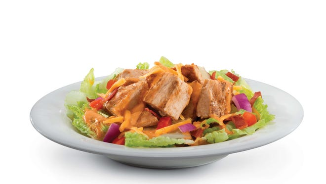 """The Hollywood Salad at Muscle Maker Grill is made with grilled chicken and turkey bacon, plus reduced-fat cheddar, vegetables and the restaurant's """"signature sauce."""""""