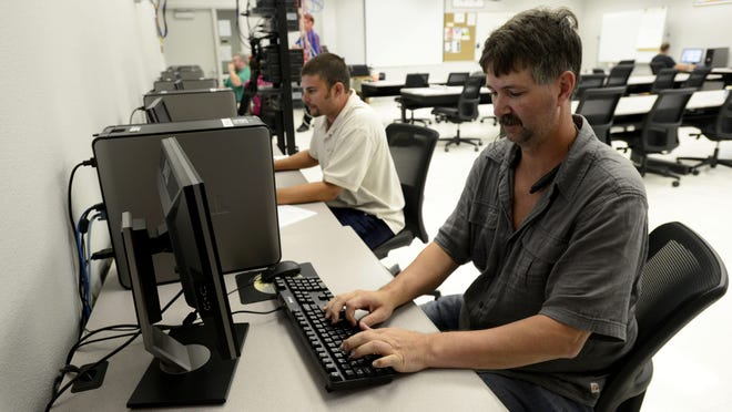 Pensacola State College students David Phillips, right, and Michael Doorbal test to be a Cisco Certified Network Associates on Tuesday during a cyber security class taught by Robert Pratten.