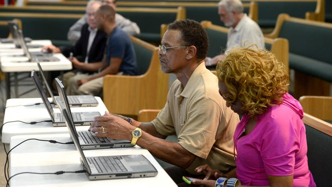 Fernandez and Rachael Sabree learn how to submit a project during a RESTORE community outreach workshop in July.