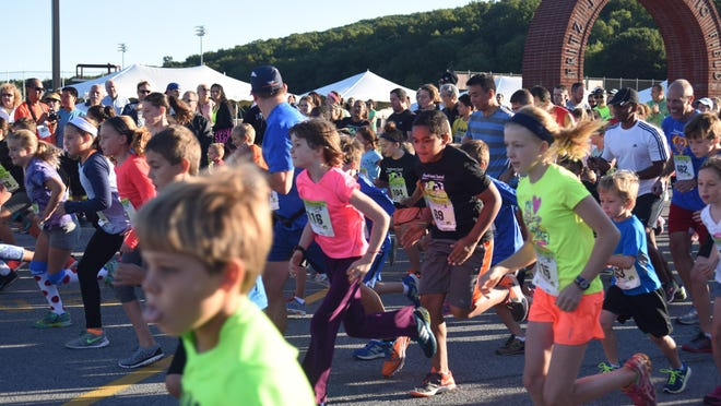 Runners begin the one-mile kids race, part of the Dutchess County Classic held at Arlington High School last year.