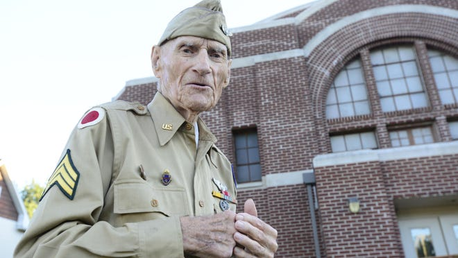 Jim McGrady, 97, of Fremont, the county's oldest living World War II veteran, in front of the old Armory where he trained for his service.