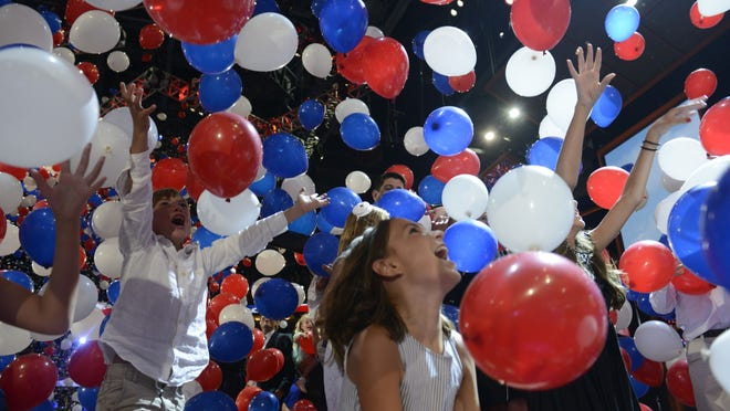 Younger members of the Romney and Ryan families play among the balloons dropped at the 2012 Republican National Convention in Tampa. (Robyn Beck, Brendan Smialowski, AFP/Getty Images)