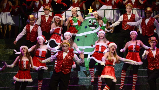 Members of the Pensacola Children's Chorus rehearse for a past Christmas on the Coast production at the Pensacola Saenger Theatre.