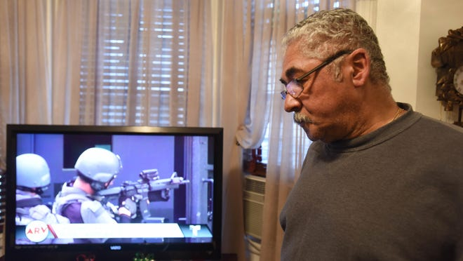 Hernan Rivera, uncle of 26-year-old Esteban Santiago, the Florida shooting suspect, watches news at his home in Union City.